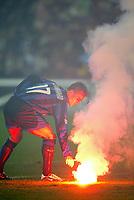 Milano 26/10/2003 <br />Inter Roma 0-0 <br />Fabio Cannavaro (Inter) raccoglie un fomogeno lanciato dai tifosi della Roma <br />Foto Andrea Staccioli / Graffiti