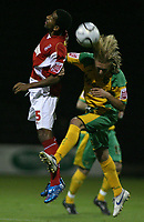 Photo: Paul Thomas.<br /> Rotherham United v Norwich City. Carling Cup. 19/09/2006.<br /> <br /> Lee Williamson of Rotherham and Robert Eagle (R) of Norwich go for the ball.