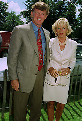 MR & MRS BROOK JOHNSON the American polo patron, at a polo match in Sussex on 20th July 1997.MAM 36