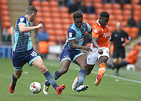 Blackpool's Bright Osayi-Samuel crosses the ball despite the attentions of Wycombe Wanderers' Anthony Stewart and Dan Rowe<br /> <br /> Photographer Stephen White/CameraSport<br /> <br /> Football - The EFL Sky Bet League Two - Blackpool v Wycombe Wanderers - Saturday 20 August 2016 - Bloomfield Road - Blackpool<br /> <br /> World Copyright © 2016 CameraSport. All rights reserved. 43 Linden Ave. Countesthorpe. Leicester. England. LE8 5PG - Tel: +44 (0) 116 277 4147 - admin@camerasport.com - www.camerasport.com