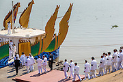 """05 FEBRUARY 2013 - PHNOM PENH, CAMBODIA:  Members of the royal family and official mourning party board the Royal Barge to go up the Mekong River to scatter the ashes of King-Father Norodom Sihanouk on the river. Sihanouk's ashes will be scattered in locations across Cambodia. Tuesday, they were scattered on the Mekong River. Norodom Sihanouk (31 October 1922- 15 October 2012) was the King of Cambodia from 1941 to 1955 and again from 1993 to 2004. He was the effective ruler of Cambodia from 1953 to 1970. After his second abdication in 2004, he was given the honorific of """"The King-Father of Cambodia."""" Sihanouk died in Beijing, China, where he was receiving medical care, on Oct. 15, 2012.   PHOTO BY JACK KURTZ"""