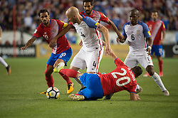September 1, 2017 - Harrison, New Jersey, U.S - Costa Rica midfielder DAVID GUZMçN (20) slide tackles USMNT midfielder MICHAEL BRADLEY (4) while Costa Rica forward BRYAN RUIZ (10) also fits for the ball during a World Cup qualifier match at Red Bull arena in Harrison, NJ.  Costa Rica defeats USA 2 to 0. (Credit Image: © Mark Smith via ZUMA Wire)