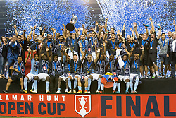 September 20, 2017 - Kansas City, Kansas, U.S - Sporting KC team members celebrate their U.S. Open Cup Championship victory. Holding up the Lamar Hunt trophy is Sporting KC's team captain, Matt Besler. At far left, in a blue suit is Sporting KC's head coach Peter Joseph Vermes. At far right is Sporting KC owner Cliff Illig. (Credit Image: © Serena S.Y. Hsu via ZUMA Wire)