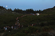 Dinner time. People coming from the different camp areas using the paths in the mountain. European Rainbow Gathering of 2011 in Portugal