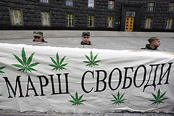 May 20, 2017 - Kiev, Ukraine - National Guard soldiers stand guard behind a placard reading ''Freedom March'' and hemps leafs images on it, during rally of activists for marijuana decriminalization, in front the Cabinet of Ministers, in Kiev, Ukraine, on 20 May 2017. Activists demand to reform and mollify the Ukrainians laws regarding the use of marijuana and other light narcotics. (Credit Image: © Serg Glovny via ZUMA Wire)