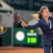 PARIS, FRANCE June 11. Chair umpire Eva Asderaki-Moore indicate the ball was out as she checks a line call during the Rafael Nadal of Spain match against Novak Djokovic of Serbia on Court Philippe-Chatrier during the semi finals of the singles competition at the 2021 French Open Tennis Tournament at Roland Garros on June 11th 2021 in Paris, France. (Photo by Tim Clayton/Corbis via Getty Images)