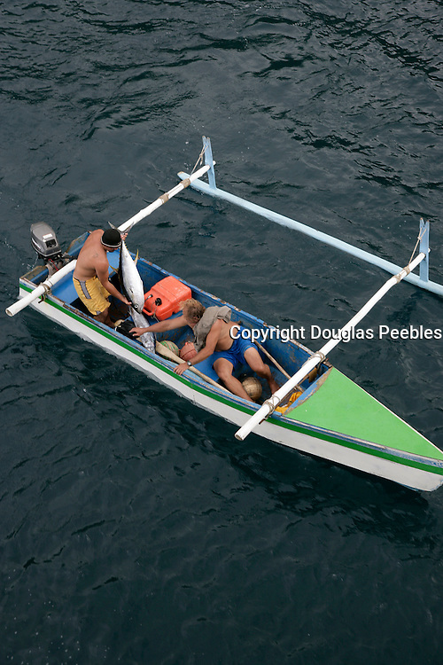 Fishing boat with tuna, Hanavave, Island of Fatu Hiva, Marquesas Islands, French Polynesia, (Editorial use only)<br />