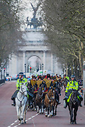 Returning down Birdcage Walk. On the 100th anniversary of women getting the vote, Kings troop is led by female officers and has a high proportion of female troopers - The King's Troop Royal Horse Artillery, ride their horses and gun carriages past Buckingham Palace to Green Park to stage a 41 Gun Royal Salute to mark the 66th Anniversary of the Accession of Her Majesty The Queen.