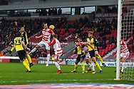 John Marquis of Doncaster Rovers (9) rises above the crowd of players to head the ball during the EFL Sky Bet League 1 match between Doncaster Rovers and Scunthorpe United at the Keepmoat Stadium, Doncaster, England on 15 December 2018.