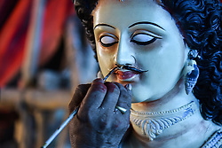 October 1, 2018 - Guwahati, India - An artist busy making idol at a workshop ahead of Durga Puja in Guwahati, Assam, India on Monday, October 1, 2018. Durga Puja, which is also known as Sharadotsav, is a Hindu festival celebrated all over India,  it marks the triumph of good over evil symbolised by the slaying of the demon called Mahisasura by Goddess Durga. (Credit Image: © David Talukdar/NurPhoto/ZUMA Press)