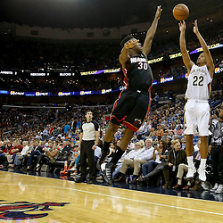 Oct 23, 2013; New Orleans, LA, USA; New Orleans Pelicans point guard Brian Roberts (22) shoots over Miami Heat point guard Norris Cole (30) during the first half of a preseason game at New Orleans Arena. Mandatory Credit: Derick E. Hingle-USA TODAY Sports