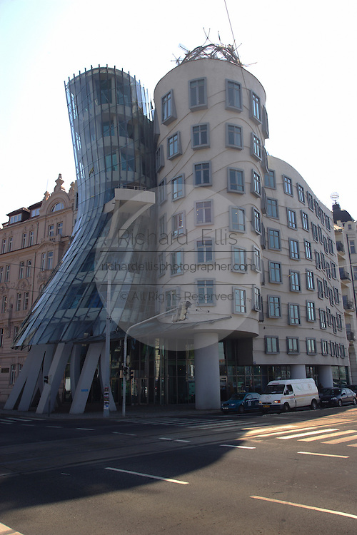"""The Dancing House (Czech: Tanc?ící du?m) is the nickname given to the Nationale-Nederlanden building in downtown Prague, Czech Republic at Ras?ínovo nábr?ez?í 80, 120 00 Praha 2. It was designed by Croatian-born Czech architect Vlado Milunic´ in co-operation with Canadian architect Frank Gehry on a vacant riverfront plot The very non-traditional design was controversial at the time. Czech president Václav Havel, who lived for decades next to the site, had supported it, hoping that the building would become a center of cultural activity...Originally named Fred and Ginger (after Fred Astaire and Ginger Rogers - the house vaguely resembles a pair of dancers) the house stands out among the Neo-Baroque, Neo-Gothic and Art Nouveau buildings for which Prague is famous. Others have nicknamed it """"Drunk House""""."""
