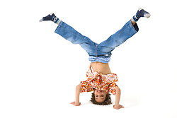 Little boy doing a headstand in the studio,