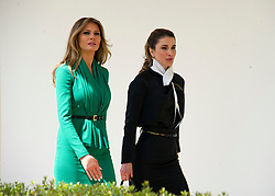 First lady Melania Trump, left, and Queen Rania of Jordan, right, walk on the White House Colonnade following the press conference conducted by their husbands, United States President Donald J. Trump and King Abdullah II of Jordan conducting a joint press conference in the Rose Garden of the White House in Washington, DC on Wednesday, April 5, 2017.<br /> Credit: Ron Sachs / CNP *** Please Use Credit from Credit Field ***