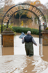 © Licensed to London News Pictures. 16/11/2019. Tewkesbury, Worcestershire, UK. People negotiate flooding at Abbey Mill in Tewkesbury in Worcestershire, UK. After several days of heavy rainfall, there is severe flooding in many parts of  Worcestershire, UK. Levels are expected to peak this afternoon.  Photo credit: Graham M. Lawrence/LNP