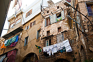 Tripoli, Lebanon - September 8, 2010: Laundry hangs from bullet scarred walls in a residential district in Tripoli, Lebanon.
