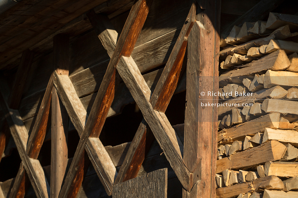 Detail of logs and timbers in a traditional Slovenian barn in a rural village, on 19th June 2018, in Bohinjska Bela, Bled, Slovenia.