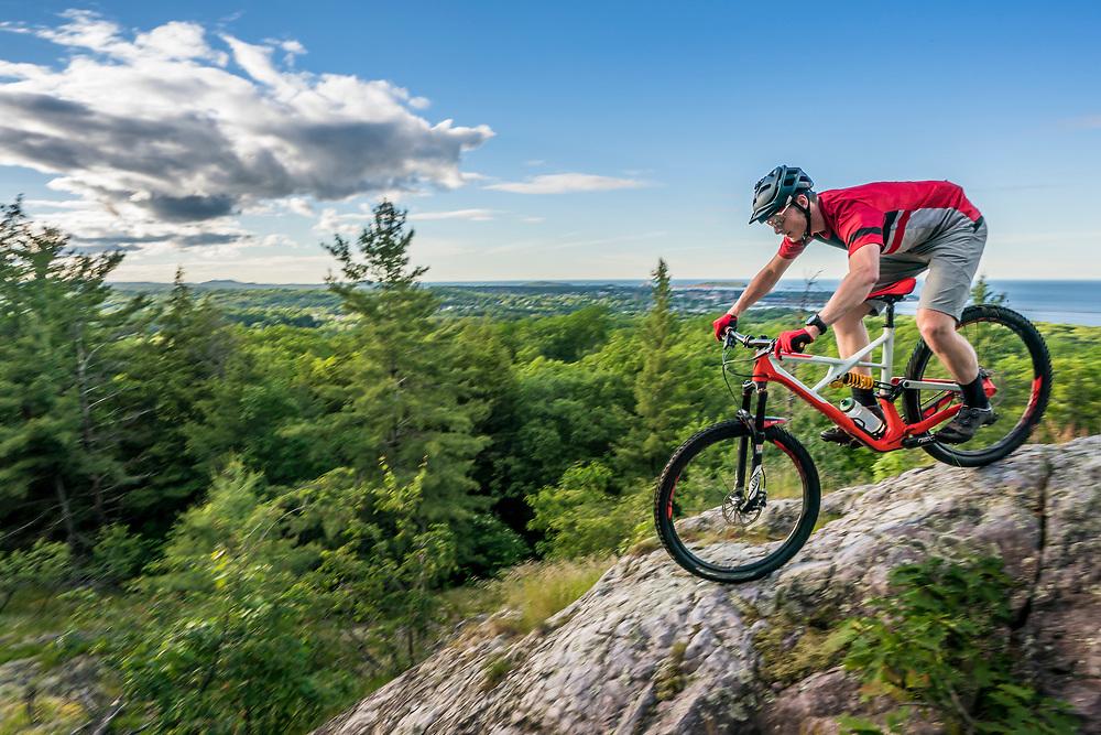 Mountain biking at Mount Marquette Overlook on the Noquemanon Trails Network South Trails in Marquette, Michigan.