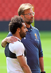 LIVERPOOL, ENGLAND - Monday, May 21, 2018: Liverpool's manager Jürgen Klopp and Mohamed Salah during a training session at Anfield ahead of the UEFA Champions League Final match between Real Madrid CF and Liverpool FC. (Pic by Paul Greenwood/Propaganda)