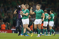 Ireland's Ian Madigan punches the air as he celebrates the Ireland win at end of match. Rugby World Cup 2015 pool D match, France v Ireland at the Millennium Stadium in Cardiff, South Wales  on Sunday 11th October 2015.<br /> pic by  Andrew Orchard, Andrew Orchard sports photography.