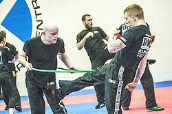Alan kicks under the hoop, Stef Noij, KMG Instructor from the Institute Krav Maga Netherlands, at the IKMS G Level Programme seminar today at the Scottish Martial Arts Centre, Alloa.