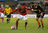 Photo: Richard Lane/Richard Lane Photography. Nottingham Forest v Blackpool. Coca Cola Championship. 13/12/2008. Nathan Tyson (L) looks for supprt and holds off Shaun Barker (L)