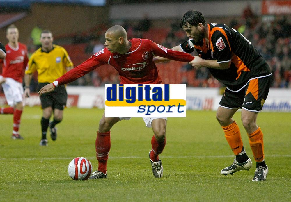 Photo: Richard Lane/Richard Lane Photography. Nottingham Forest v Blackpool. Coca Cola Championship. 13/12/2008. Nathan Tyson (L) looks for supprt and holds off Shaun Barker (L)