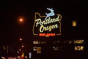 Portland Oregon neon sign at night while driving over Burnside Bridge