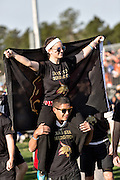 Teams enter the playing field during the opening ceremonies for the 7th Annual Quidditch World Cup April 5, 2014 in Myrtle Beach, South Carolina. The sport, created from the Harry Potter novels is a co-ed contact sport with elements from rugby, basketball, and dodgeball. A quidditch team is made up of seven athletes who play with broomsticks between their legs at all times.