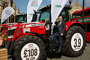 Minister for Agriculture George Eustice at the National Farmers Union NFU took machinery, produce, farmers and staff to Westminster to encourage Members of Parliament to back British farming, post Brexit on 14th September 2016 in London, United Kingdom. MPs were encouraged to sign the NFU's pledge and wear a British wheat and wool pin badge to show their support.