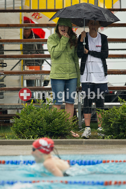 Spectators watch a race during the Swiss Swimming Summer Championships held at the 50m outdoor pool Colovray in Nyon, Switzerland, Sunday, July 1, 2012. (Photo by Patrick B. Kraemer / MAGICPBK)