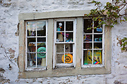 The odd angle of a cottage window in the Yorkshire Dales National Park, on 12th April 2017, in Malham, Yorkshire, England.