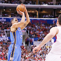 11 May 2014: Oklahoma City Thunder guard Thabo Sefolosha (25) takes a jump shot during the Los Angeles Clippers 101-99 victory over the Oklahoma City Thunder, during Game Four of the Western Conference Semifinals of the NBA Playoffs, at the Staples Center, Los Angeles, California, USA.