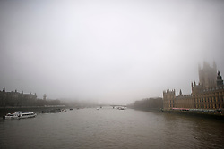 © Licensed to London News Pictures. 22/02/2019. London, UK. Fog shrouds the River Thames at The House Of Parliament in the early morning at Westminster in Central London. Record temperatures for February have been predicted for next week. Photo credit: Ben Cawthra/LNP