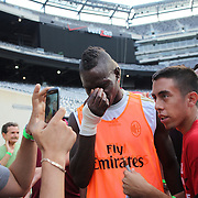 Mario Balotelli with fans after training with AC Milan in preparation for the Guinness International Champions Cup tie with Chelsea at MetLife Stadium, East Rutherford, New Jersey, USA.  3rd August 2013. Photo Tim Clayton