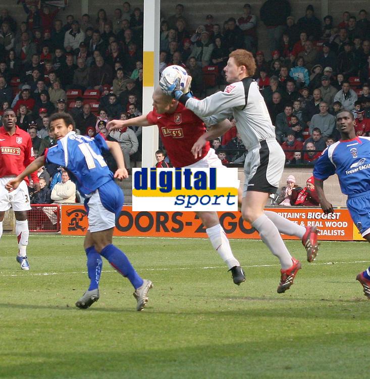 Photo: Mark Stephenson.<br />Walsall v Accrington Stanley. Coca Cola League 2. 31/03/2007. Walsall's Michael Dobsonr tries to beat Accrington's keeper David Martin