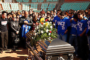 Family and teammates of Jaime Irigoyen, a 19-year-old baseball player and law student gather at the Juarez Indios baseball stadium, for a memorial service for the slain youth in Juarez, Mexico January 16, 2009. Irigoyen was reportedly grabbed by the military from his home and found executed the neat mourning. An ongoing drug war has already claimed more than 40 people since the start of the year. More than 1600 people were killed in Juarez in 2008, making Juarez the most violent city in Mexico.    (Photo by Richard Ellis)