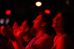 Fans applaud comedian Doug Stanhope as he performs onstage at Antones in downtown Austin, Texas on Aug. 3, 2008. Stanhope will be performing at the Edinburgh Festival.