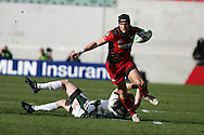 Andy Fenby of the Scarlets breaks away from the tackle from Tom Homer of London Irish. Heineken cup rugby, Scarlets v London Irish at the Parc y Scarlets stadium in Llanelli on Sunday 17th Jan 2010.  pic by  Andrew Orchard  , Andrew Orchard sports photography,