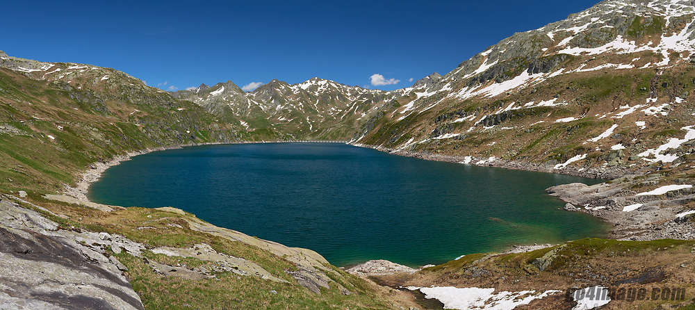June 2018 Lake Lucendro on the Gotthard in the Swiss Alps. The lake is a Dam wich is used to produce electricity.