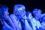 The crowd in pensive mood as they await Laura Marling and Mike Lindsay to play together in LUMP -The 2018 Latitude Festival, Henham Park. Suffolk 13 July 2018