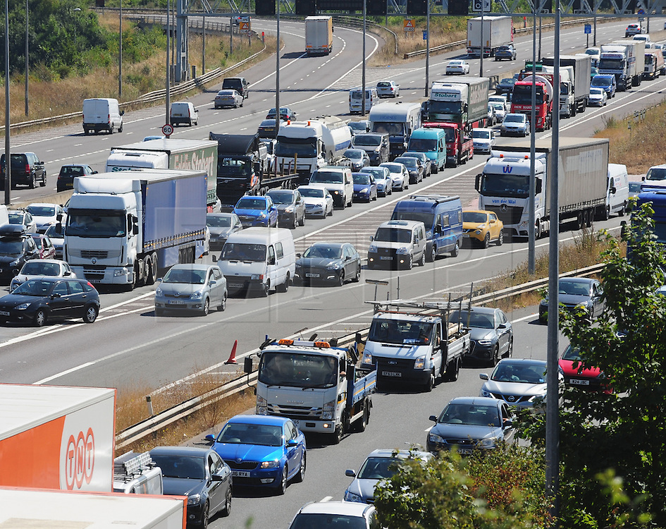 © Licensed to London News Pictures. 26/08/2016<br /> BANK HOLIDAY TRAFFIC GET AWAY M25 KENT.<br /> Traffic hell Anti-clockwise towards Dartford River Crossing on the M25 at Dartford in Kent this afternoon.<br /> (Byline:Grant Falvey/LNP)