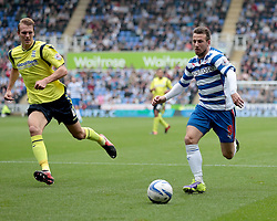 Reading's Adam Le Fondre is shadowed by Birmingham City's  Dan Burn  - Photo mandatory by-line: Nigel Pitts-Drake/JMP - Tel: Mobile: 07966 386802 28/09/2013 - SPORT - FOOTBALL - Madejski Stadium - Reading - Reading V Birmingham City - Sky Bet Championship
