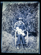 happy grandfather with baby sitting in garden outdoors France ca 1920s