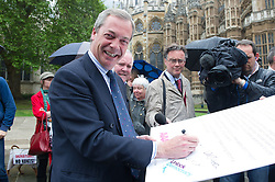 © London News Pictures. 18/05/15. London, UK. Nigel Farage, leader of the UKIP party, signs a petition for electoral reform, Westminster, Central London. Photo credit: Laura Lean/LNP/05/15.