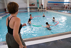 Group of pregnant women taking part in an Aquanatal class,