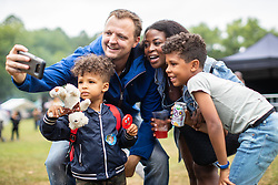 © Licensed to London News Pictures . 12/08/2018. Manchester , UK . Father GERLOF KASMA (37) , his wife JANICE KASMA (33) and their sons JACOB KASMA (three) and HARMEN KASMA (seven) , from Sale . The second day of the annual Caribbean Carnival in Alexandra Park in Moss Side , celebrating music , food and Afro-Caribbean culture . A nearby shooting overnight lead to at least ten people injured . Ten people are in hospital . Photo credit : Joel Goodman/LNP