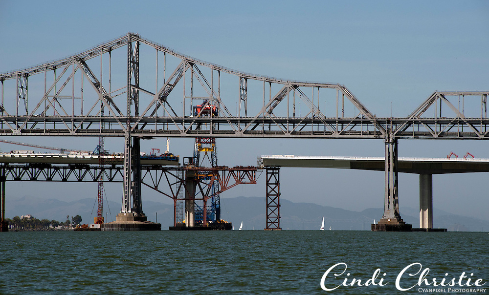 The eastern span of the San Francisco-Oakland Bay Bridge, background, remains under construction on Saturday, Sept. 17, 2011, in the San Francisco Bay.  The original eastern span, foreground, was damaged in the 1989 Loma Prieta earthquake. The new self-anchored suspension span is expected to open in 2013. (© 2011 Cindi Christie/Cyanpixel Photography)