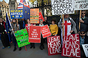 On the day the Prime Minister brings his Brexit bill for a vote at the House of Commons, Pro Brexit anti European Union Leave protesters demonstrate alongside Remain anti-Brexit protesters in Westminster on 22nd October 2019 in London, England, United Kingdom. Brexit is the scheduled withdrawal of the United Kingdom from the European Union. Following a June 2016 referendum, in which 51.9% of participating voters voted to leave.