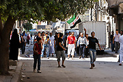 People along with students gathered to protest against the Syrian government on Friday, June 8, 2012. They threw stones and shouted anti-government slogans, while Syrian state security forces bearing guns such as AK47 shoot in the air aiming to disperse Syrian protestors. The protest ended within two hours, reportedly there has been several protestors injured. (Photo by Vudi Xhymshiti)